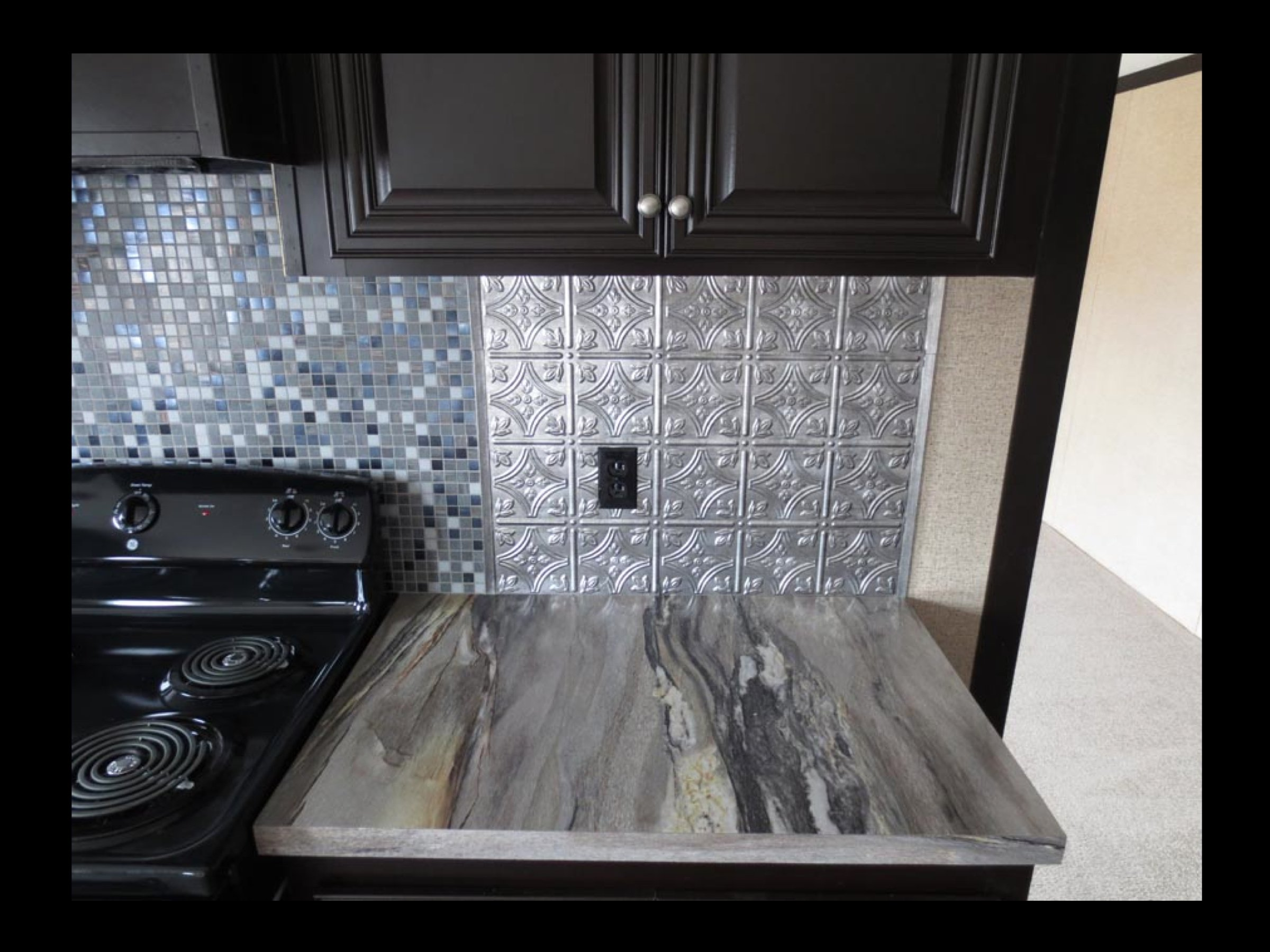 Black Cabinets and Blue Storm Formica Countertops